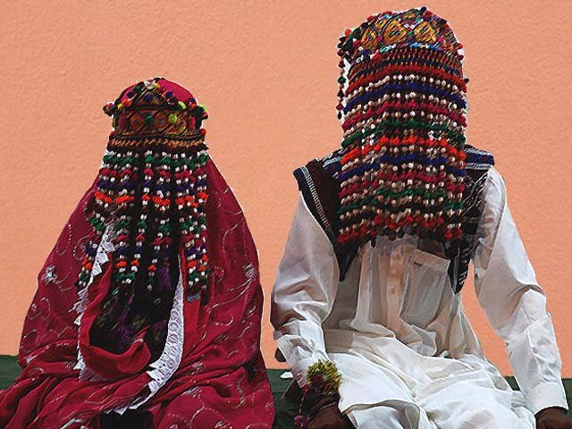 A bride and groom wait for their wedding to start during a mass marriage ceremony in Karachi. PHOTO: REUTERS