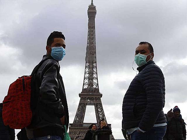 People with protective masks walk on the Trocadero esplanade. PHOTO: GETTY