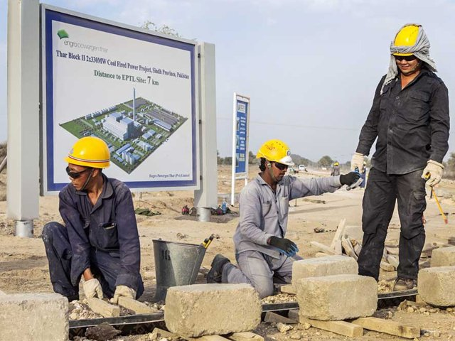Chinese and Pakistani workers at the Sindh Engro Coal Mining Co. site in Thar.  PHOTO: GETTY
