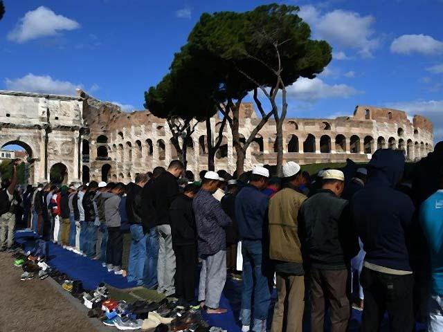 Muslim men attend Friday prayers near Rome's ancient Colosseum. PHOTO: AFP
