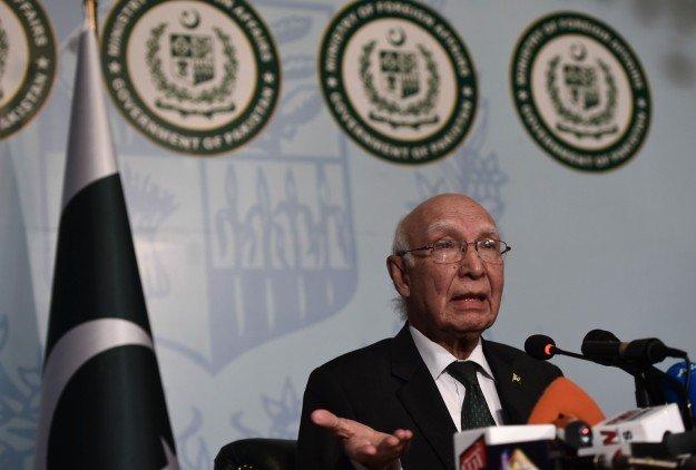 Sartaj Aziz addresses a press conference in Islamabad. PHOTO: AFP