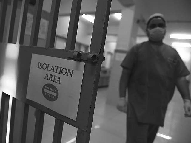 A medical staff member walks in an isolation ward at the Jinnah Post Graduate Medical Center (JPMC). PHOTO: GETTY