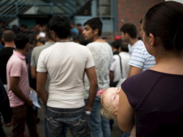 asylum seekers wait in front of the federal office for migration and refugees bamf at berlin 039 s spandau district germany august 17 2015 photo reuters