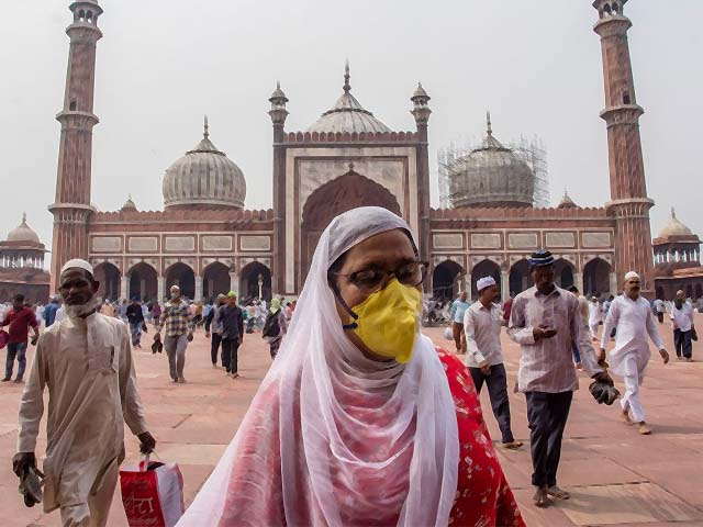 a indian muslim woman wearing a protective mask leaves after attending congregational friday prayers at the historic jama masjid photo afp