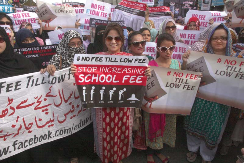 Parents protest outside Karachi Press Club on Tuesday against the hefty increase in school fees by private schools and demand a monitoring body be set up to inspect such hikes. PHOTO: ATHAR KHAN/EXPRESS