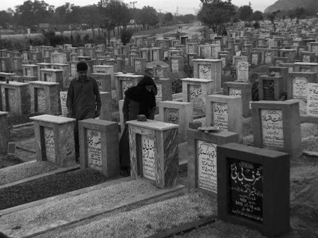 residents belonging to the ahmadi sect visit a cemetery at rabwah photo afp
