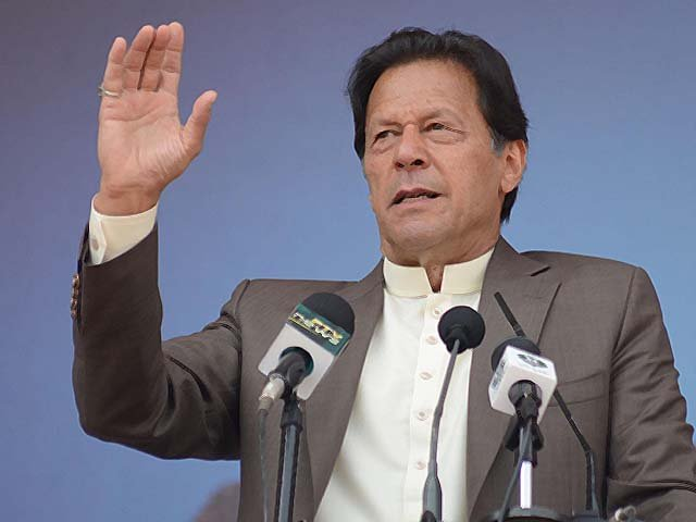 Pakistani Prime Minister Imran Khan addresses people during a ceremony. PHOTO: AFP