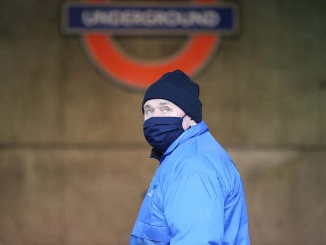 A man wears a medical mask as a precaution against COVID-19 outside of Westminster underground station. PHOTO: AFP