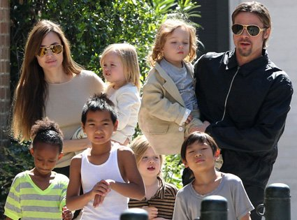 angelina jolie and brad pitt are reportedly adopting a syrian refugee