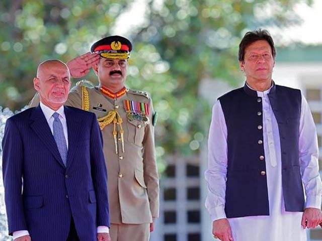 visiting afghan president ashraf ghani and prime minister imran khan review an honour guard photo afp