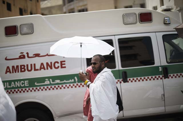 Saudi ambulances arrive with pilgrims who were injured in a stampede at an emergency hospital in Mina on the first day of Eidul Azha on September 24, 2015. PHOTO: AFP