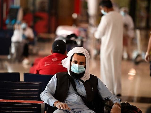 A Pakistani national waits at the Dubai International Airport. PHOTO: AFP