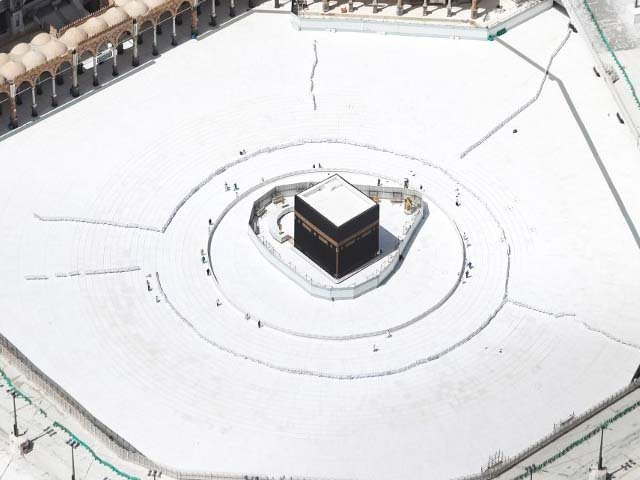 a few workers are seen nearby an empty kaaba after the precautions against the novel coronavirus photo afp