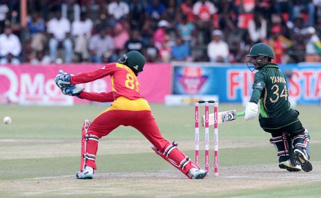 Pakistan's batsman Amir Yamin (R) gets one past Zimbabwe's wicket keeper Richmond Mutumbami (L) during the second game in a series of three ODI cricket matches between Zimbabwe and Pakistan on October 3, 2015 at the Harare Sports Club, in Harare. PHOTO: AFP