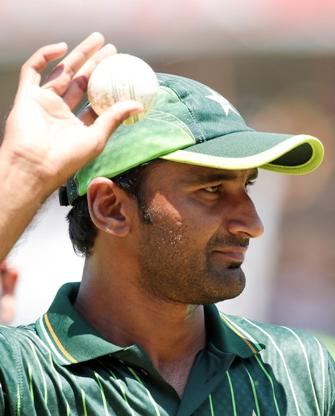 Bilal Asif raises the match ball after taking a fifer against Zimbabwe. PHOTO: AFP