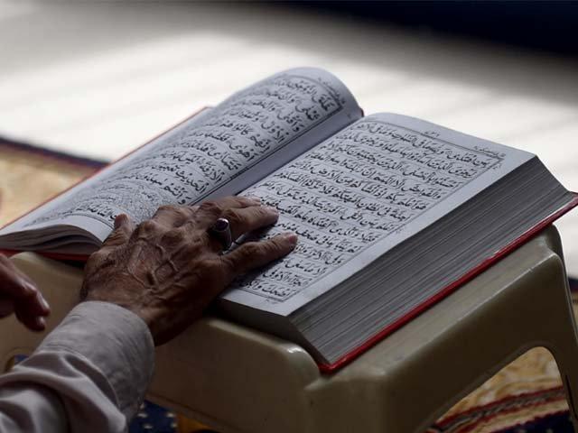 a pakistani muslim devotee recites the quran photo afp