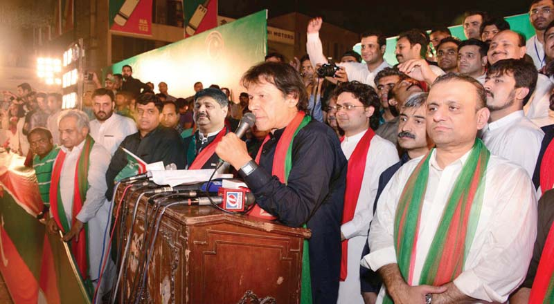 Imran Khan leads a campaign rally for NA-122 by-elections. PHOTO: INP