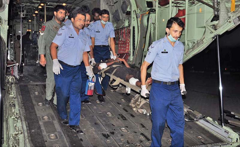 paf staff carry those injured in the jacobabad bomb blast on muharram 9 out of the c 130 aircraft in karachi photo online