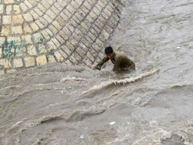 in this file 2012 photo a boy tries to get out of a flooded street following heavy rains in sanaa yemen photo reuters