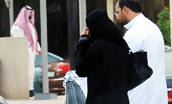 In this file photo, a Saudi couple walk in Riyadh. PHOTO: AFP