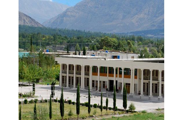 black and blue karakoram university students protest against attack on professor