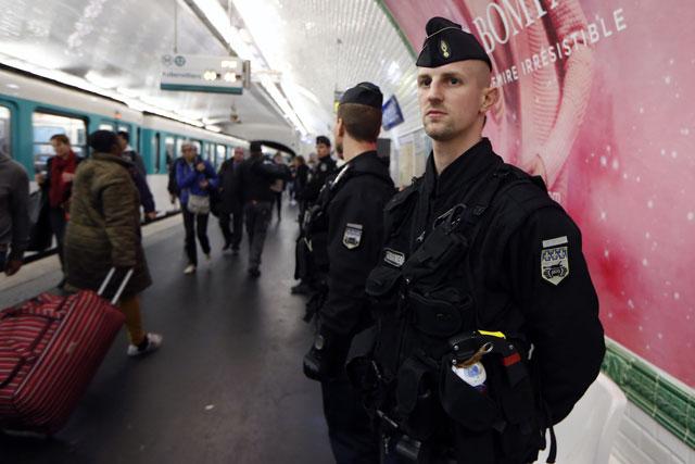 french gendarmes enforcing the vigipirate plan france 039 s national security alert system patrol on november 19 2015 in a railway station paris photo afp