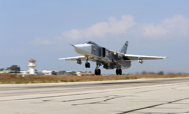 a file picture taken on october 3 2015 shows a russian sukhoi su 24 bomber taking off from the hmeimim airbase in the syrian province of latakia photo afp