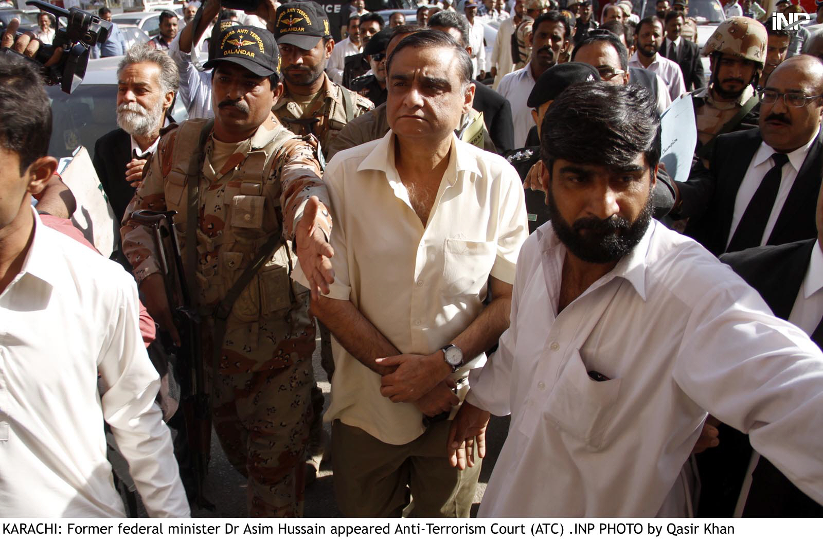 Former minister Dr Asim Hussain arrives to appear before an Anti Terrorism Court in Karachi on November 26, 2015. PHOTO: FILE