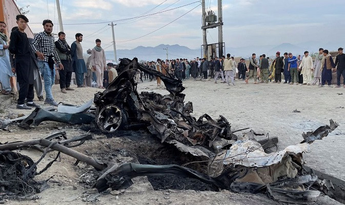 people stand at the site of a blast in kabul afghanistan may 8 2021 photo reuters