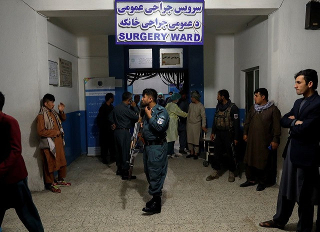 An Afghan policeman stands guard inside a hospital, after a blast in Kabul, Afghanistan May 8, 2021. PHOTO: REUTERS