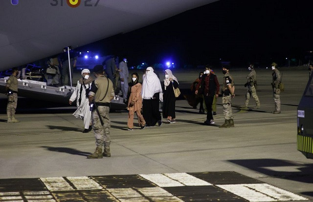Spanish and Afghan citizens who were evacuated from Kabul arrive at Torrejon airbase in Torrejon de Ardoz, outside Madrid, August 19, 2021. PHOTO: REUTERS