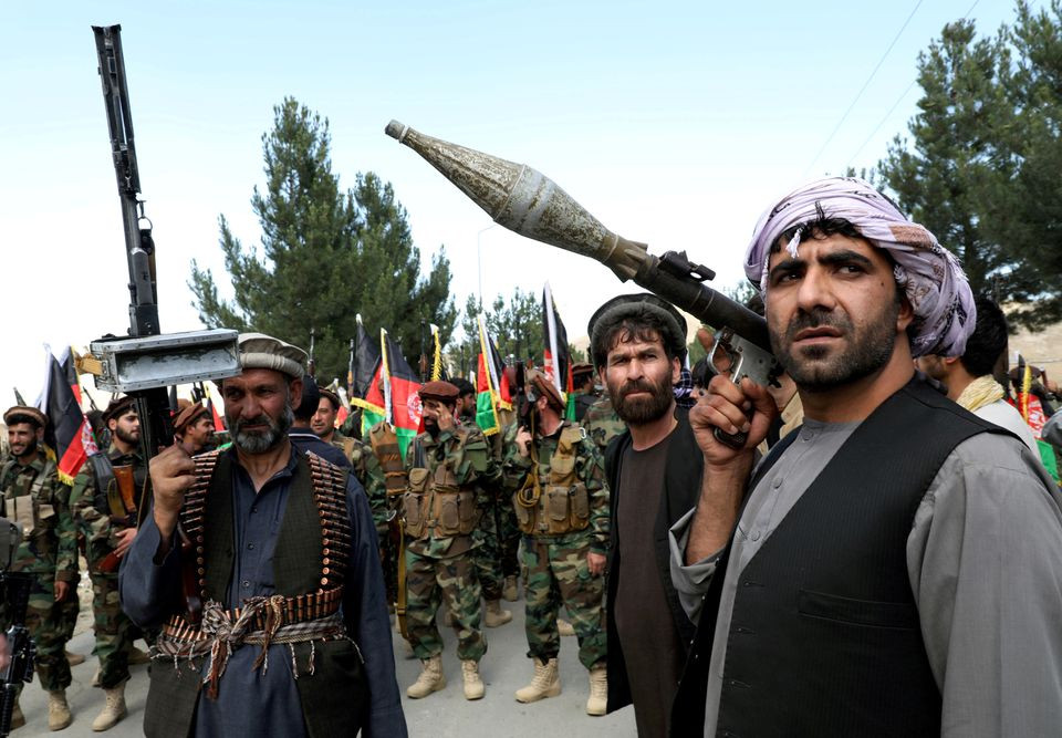 armed men attend a gathering to announce their support for afghan security forces and that they are ready to fight against the taliban on the outskirts of kabul afghanistan june 23 2021 photo reuters