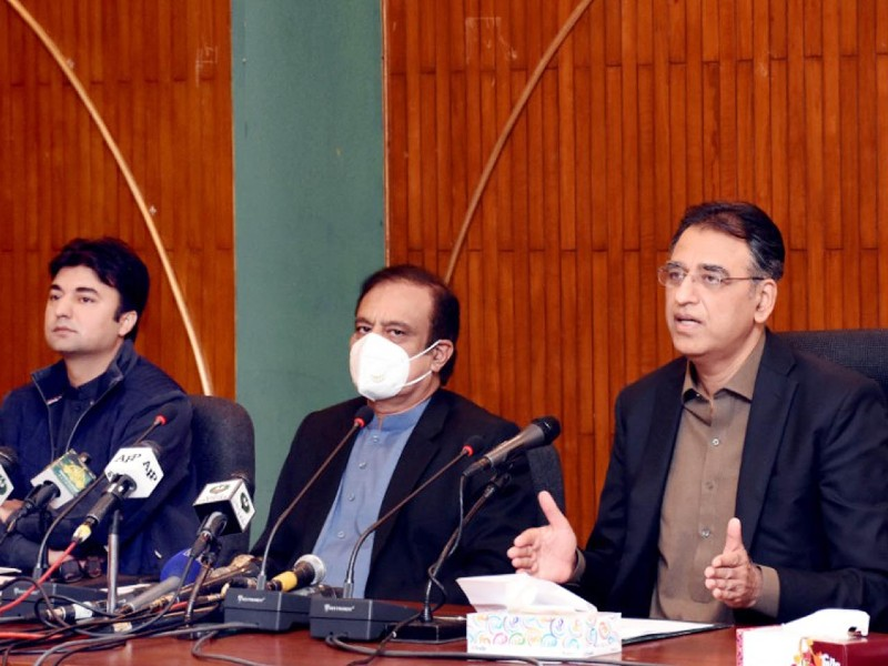 federal minister for planning development and special initiatives asad umar along with federal minister for information and broadcasting senator shibli faraz federal minister for communication murad saeed addressing a press conference in islamabad on november 19 2020 photo pid