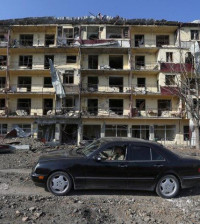 a-man-drives-a-car-past-a-damaged-building-following-recent-shelling-in-the-town-of-shushi-shusha-in-the-course-of-a-military-conflict-over-the-breakaway-region-of-nagorno-karabakh-october-29-2020-photo-reuters