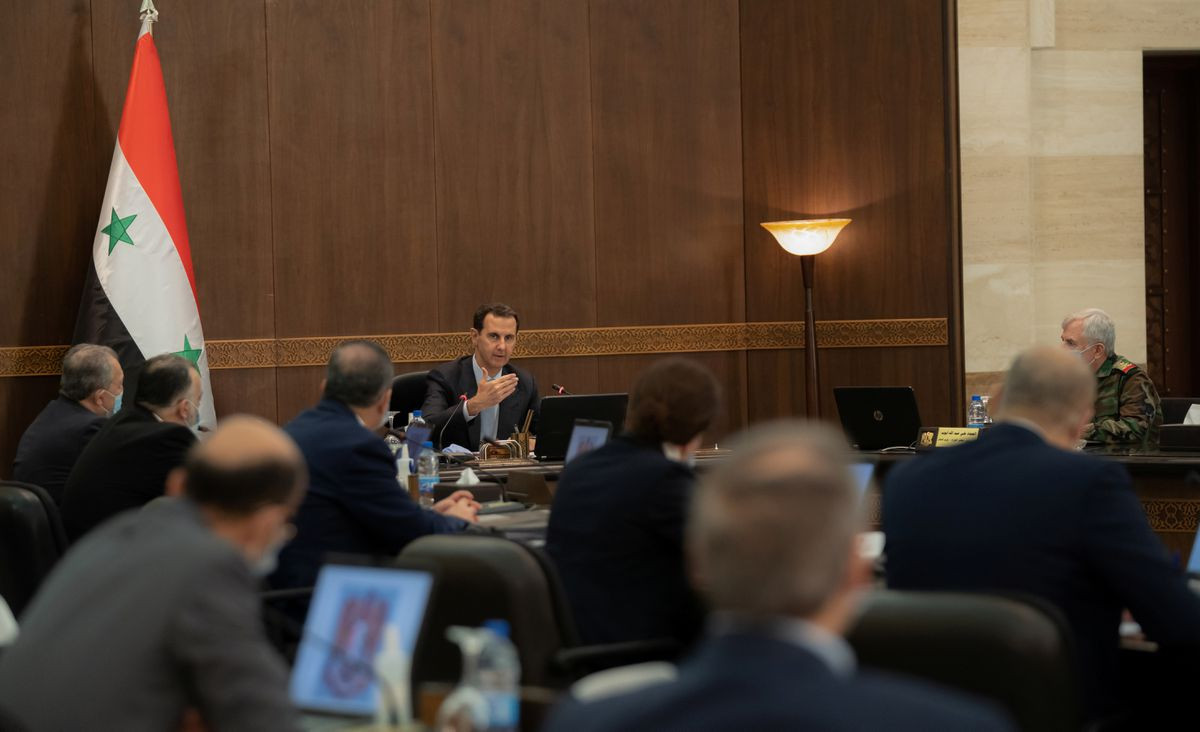 syria s president bashar al assad speaks as he meets with the syrian cabinet in damascus syria in this handout picture released by sana on march 30 2021 sana handout via reuters