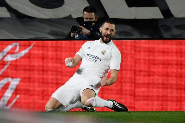 in form benzema has madrid on right track for title charge
