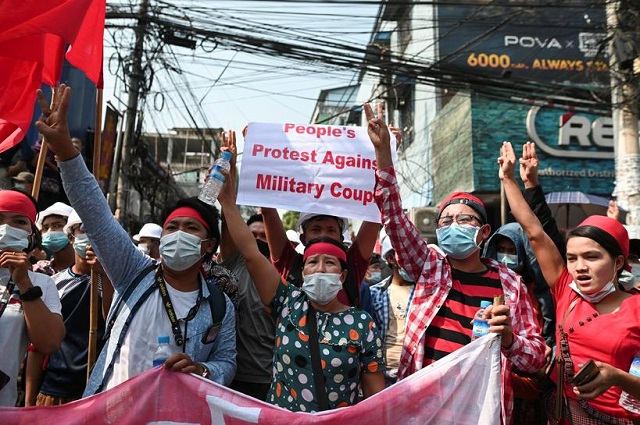 demonstrators show the three finger salute to protest against the military coup and demand the release of elected leader aung san suu kyi in yangon myanmar february 6 2021 photo reuters