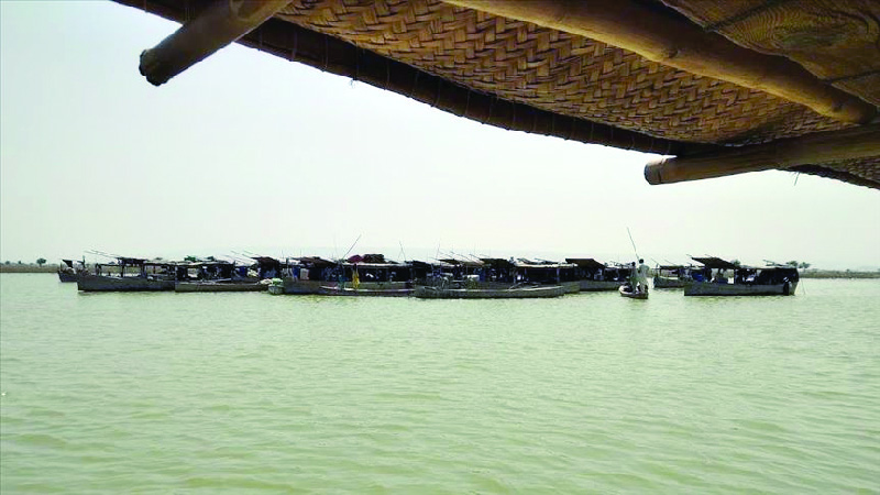 centuries old boat village faces dual threat