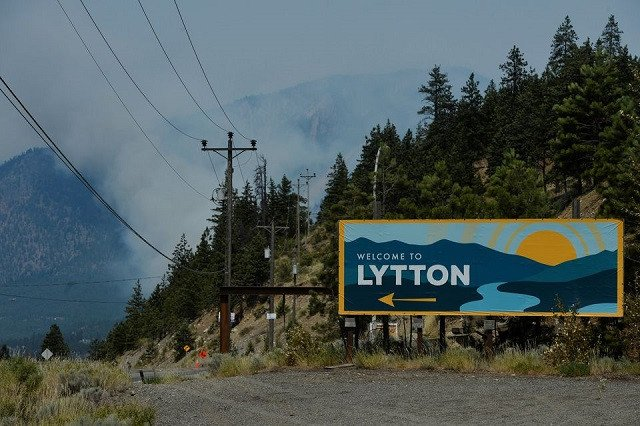 The sign for the town of Lytton, where a wildfire raged through and forced residents to evacuate, is seen in Lytton, British Columbia, Canada July 1, 2021. PHOTO: REUTERS