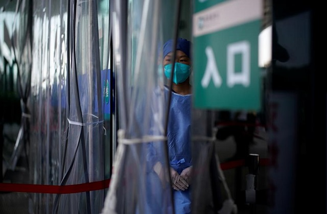 a worker wears a mask during a government organised media tour at tongji hospital following the coronavirus disease covid 19 outbreak in wuhan hubei province china september 3 2020 photo reuters