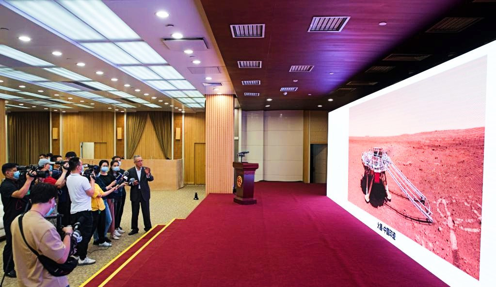Zhang Rongqiao, chief designer of China's first Mars exploration mission, introduces the new images taken by China's first Mars rover Zhurong at the ceremony during which the images are unveiled in Beijing, capital of China, June 11, 2021. PHOTO: XINHUA
