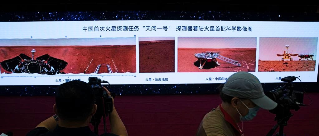 Journalists work at the ceremony during which new images taken by China's first Mars rover Zhurong are unveiled in Beijing, capital of China, June 11, 2021. PHOTO: XINHUA