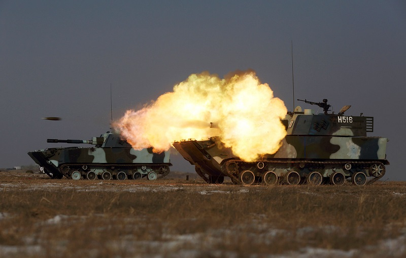 A tank of the People's Liberation Army Navy Marine Corps fires during a military drill at a base in China's Jilin province in 2015. PHOTO: REUTERS