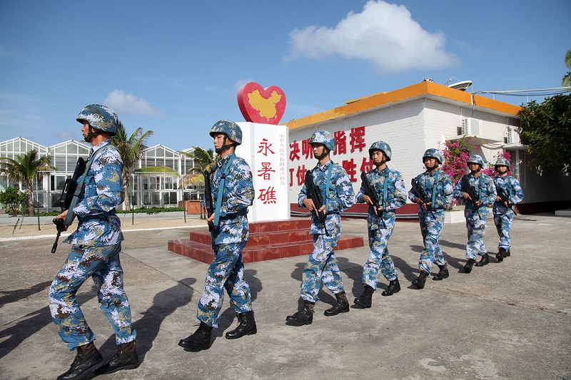 Members of the Chinese navy patrol at Fiery Cross Reef in the Spratly Islands in 2016. China refers to this contested group of islands and reefs in the South China Sea as the Nansha Islands. PHOTO: REUTERS