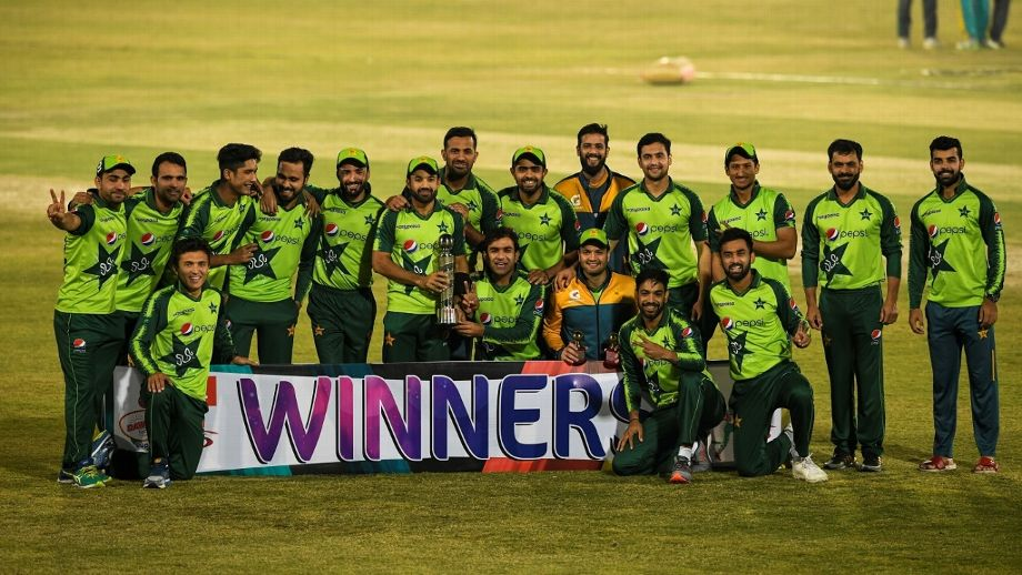pakistan team posing with the trophy after beating zimbabwe at home photo afp