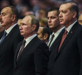 russian-president-vladimir-putin-stands-next-to-his-turkish-counterpart-recep-tayyip-erdogan-at-the-world-energy-congress-source-afp