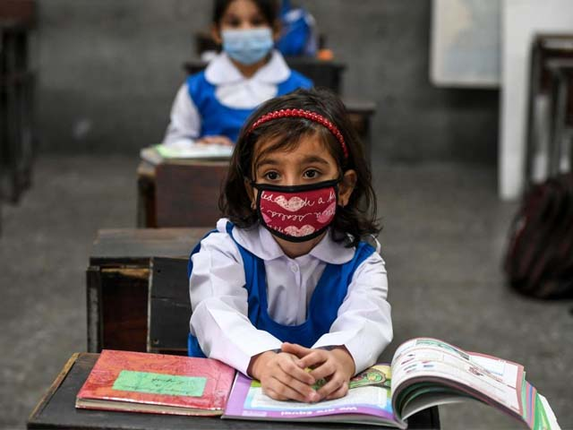 children attend a class at a school in islamabad photo afp