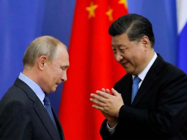 xi jinping and vladimir putin during a meeting photo reuters
