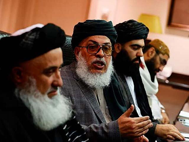 a taliban delegation holds a press conference after a meeting with zamir kabulov photo afp