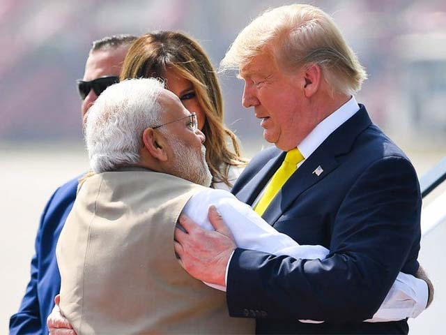 narendra modi embraces donald trump upon his arrival in ahmedabad on february 24 2020 photo afp
